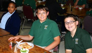 Students from St. Francis of Assisi School in Cleveland came to St. Helen School to celebrate the day together. As partner schools, they exchange letters, go on field trips together and enjoy a day doing different activities. Seventh-graders Mason Mulacek and Bradford Fram enjoy their lunch with one of their friends from St. Francis.