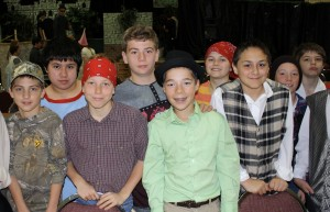 "St. Helen School sixth-graders (l to r) front row: Monte Myer, Dane Berschig, Christopher Carter, Elliott Martin; and back row: Nate Looker, Danny Hoenigman, Jimmy Mislay, Joe Barcikoski and Nick Wozniak get ready to practice for their spring play, ""Princess Whatsername."""