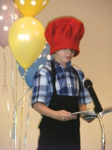 "Jacob Schneider recites the poem, ""A Pizza the Size of the Sun,"" during the third-grade poetry recital at St. Mary School."