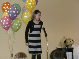 "St. Mary School third-grader Sierra Berman recites ""The Hairy Dog"" during the poetry recital."