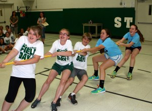 Submitted During field day at St. Helen School, sixth-grader Makayla Hart, seventh-graders Melanie Rakoczy and Andrew Kolenic and eighth-graders Lily Martin and Clare Chesler have fun participating in tug-of-war.