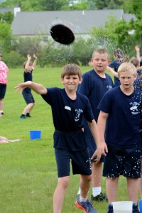 Submitted Fun in the sun! Mark Hribar, Kyle Yates and Ethan McCaskey get soaked while playing water Frisbee during the annual field day events at St. Mary School.